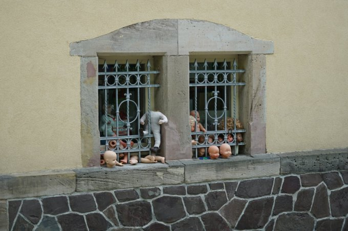 The window of a doll repair shop...